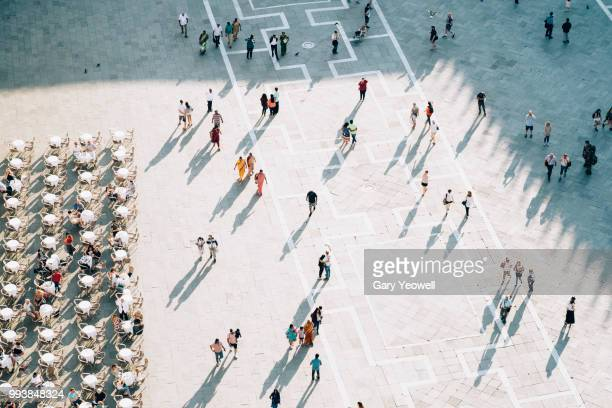 birdseye view of people in st mark's square, venice - courtyard stock pictures, royalty-free photos & images