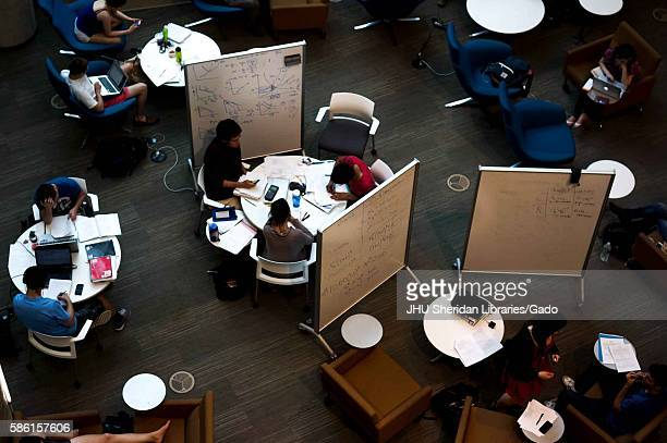 Bird's-eye view of round tables and portable white boards on the main floor of Brody Learning Commons at Johns Hopkins University, where college...
