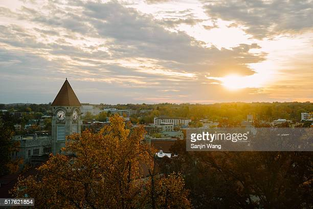 bird's-eye view of the City of Bloomington, Indiana and the campus of Indiana University with sunset in fall