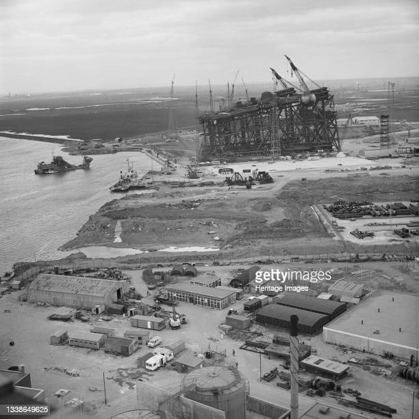 Bird's-eye view of the oil platform Graythorp I lying on its side in the dry dock basin at Graythorp. In the early 1970s Laing Pipelines Offshore...