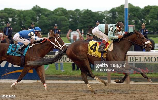 Birdstone with jockey Edgar Prado aboard beats out Smarty Jones and jockey Stewart Elliott to win the 136th running of the Belmont Stakes at Belmont...