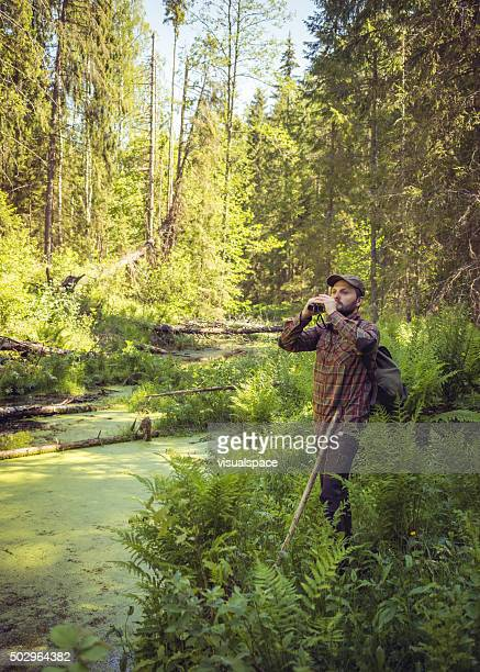 Birdwatcher In A Bog Observing The Environment