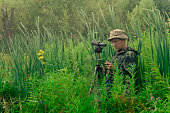 man birdwatcher records results observations while
