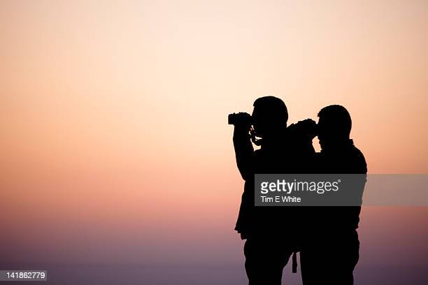 Birdwatchers at dusk in the lower Pyrenees Catalonia Northern Spain