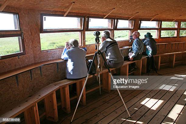 Birdwatchers in hide at Minsmere RSPB Royal Society for the Protection of Birds bird reserve Suffolk England