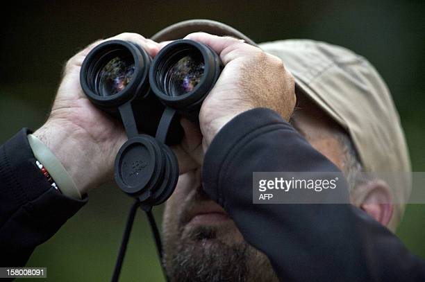 Birdwatchers spot birds during the Birding Rally Challenge at 'Aguas Calientes' near the Machu Picchu sanctuary in Cuzco on December 05 2012 The...