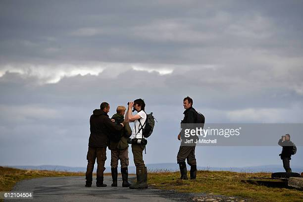 Birdwatchers walk from Hametoun on the Island of Foula on October 1 2016 in Foula Scotland Foula is the remotest inhabited island in Great Britain...
