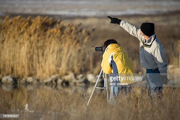 Birdwatching Couple-man pointing