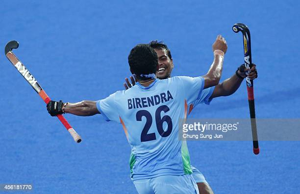 Birendra Lakra of India celebrates after scores a goal during the Hockey Men's Pool B match between India and China during the 2014 Asian Games at...
