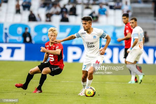 Birger MELING of Rennes and Cengiz UNDER of Marseille during the Ligue 1 Uber Eats match between Marseille and Rennes at Orange Velodrome on...