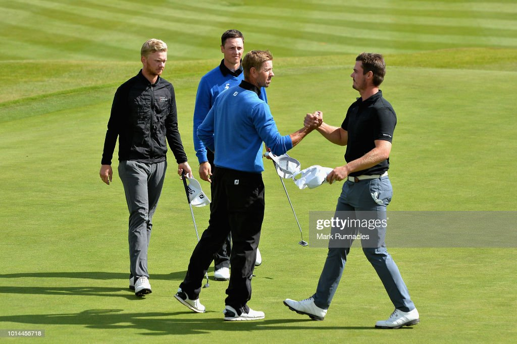 Birgir Hafthorsson and Axel Boasson of Iceland shake hands with Jarand Ekelund Arnoy and Kristian Krogh Johannessen of Norway after their match during day three of the European Golf Team Championships at Gleneagles on August 10, 2018 in Auchterarder, Scotland. This event forms part of the first multi-sport European Championships.