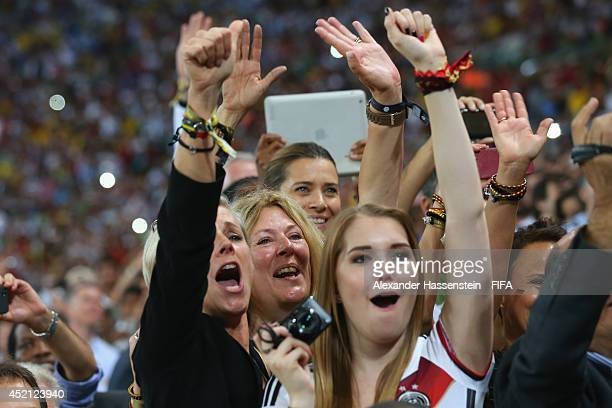 Birgit Koepke , Daniela Loew and Klara Szalantzy celebrate winning the World Cup after the 2014 FIFA World Cup Brazil Final match between Germany and...