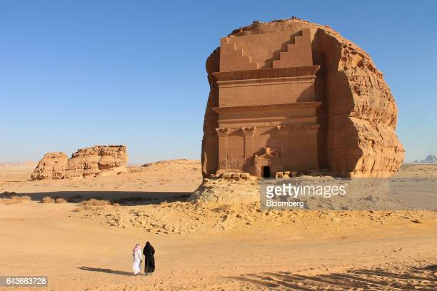 Birgit Mitchell, an American tourist, right, visits Mada'in Saleh, a UNESCO World Heritage Site, with her guide in Mada'in Saleh, Saudi Arabia, on...