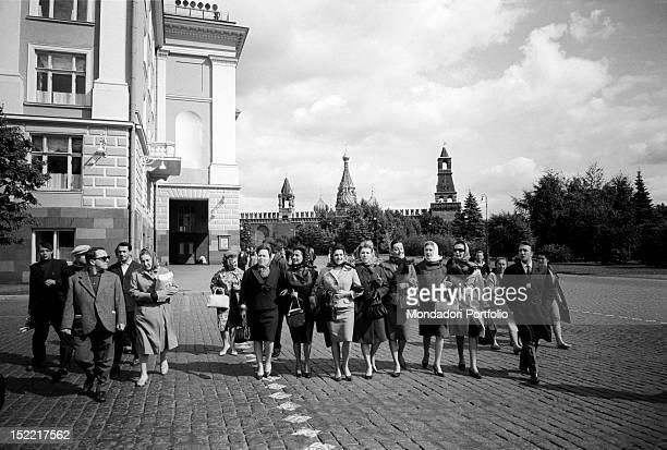 Birgit Nilsson Fiorenza Cossotto Mirella Freni Gabriella Tucci Edda Vincenzi going arm in arm for a stroll in Moscow with other collegues behind them...