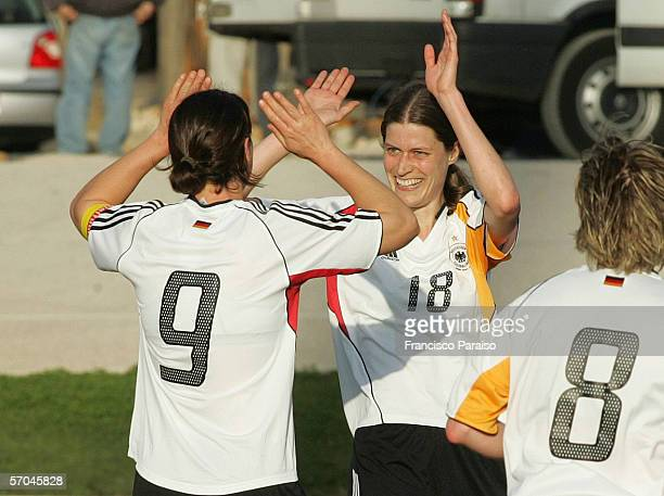 Birgit Prinz and Kerstin Garefrekes of Germany celebrate after winning against Finland during the Womens Algarve Cup match between Germany and...