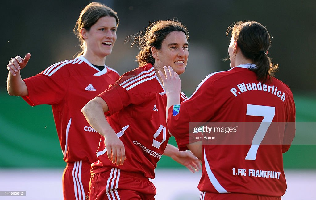 Birgit Prinz of Frankfurt celebrates with team mates Kerstin Garefrekes and Pia Wunderlich after scoring her teams second goal during the Birgit Prinz farewell match between Germany and 1. FFC Frankfurt at Volksbank stadium on March 27, 2012 in Frankfurt am Main, Germany.