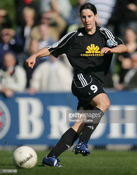 Birgit Prinz of Frankfurt runs with the ball during the Women's Bundesliga match between FCR 2001 Duisburg and 1 FFC Frankfurt at the PCC Stadium on...