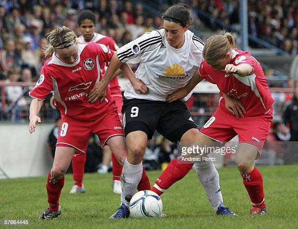 Birgit Prinz of Frankfurt vies for the ball with Conny Pohlers and Petra Wimbersky of Potsdam during the Women's UEFA Cup Final first leg match...