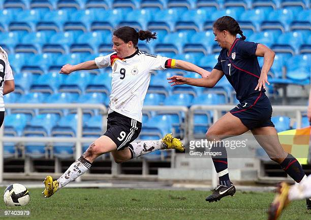 Birgit Prinz of Germany and Shanon Boxx of USA battle for the ball during the Women Algarve Cup match between Germany and USA on March 3, 2010 in...