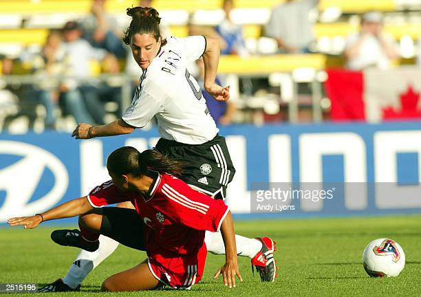 Birgit Prinz of Germany and Sharolta Nonen of Canada battle for the ball during the Fifa Women's World Cup September 20 2003 at Crew Stadium in...