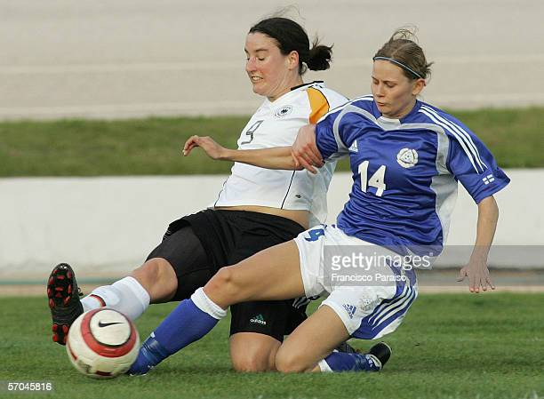 Birgit Prinz of Germany and Veera Vartiainen of Finland battle for the ball during the Womens Algarve Cup match between Germany and Finland on March...