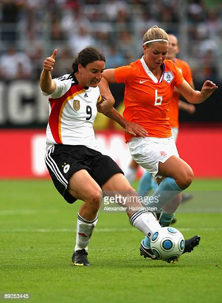Birgit Prinz of Germany battles for the ball with Anouk Hoogendijk of the Netherlands during the Women's international friendly match between Germany...