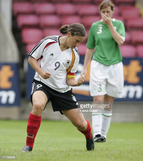 Birgit Prinz of Germany celebrates scoring Germany's second goal during the FIFA Womens World Cup qualifier between the Republic of Ireland and...