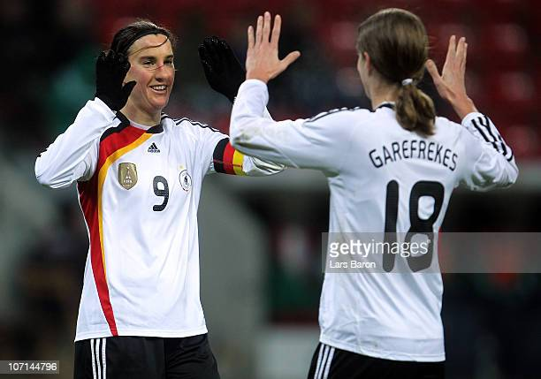 Birgit Prinz of Germany celebrates with Kerstin Garefrekes after scoring her team's fourth goal during the women's international friendly match...