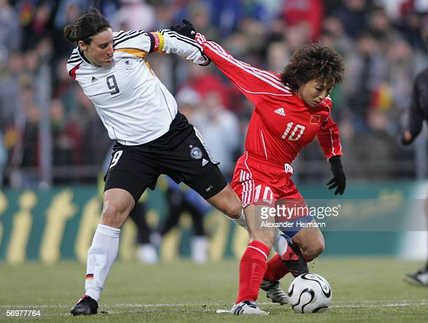 Birgit Prinz of Germany competes with Sun Wen of China during the women's international friendly match between Germany and China on March 1 2006 in...