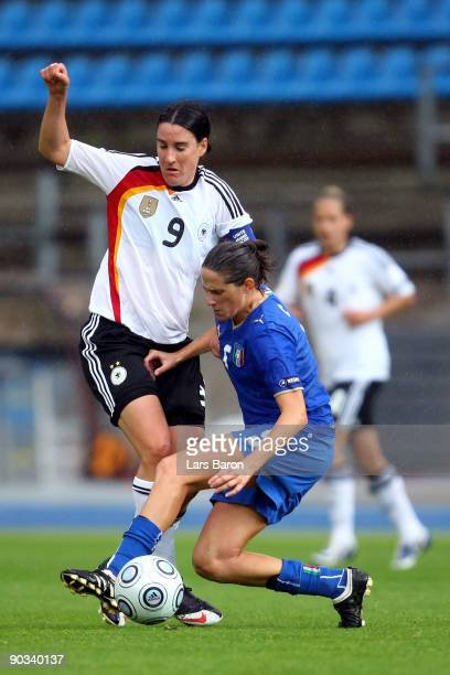 Birgit Prinz of Germany is challenged by Patrizia Panico of Italy during the UEFA Women's Euro 2009 quarter final match between Germany and Italy at...