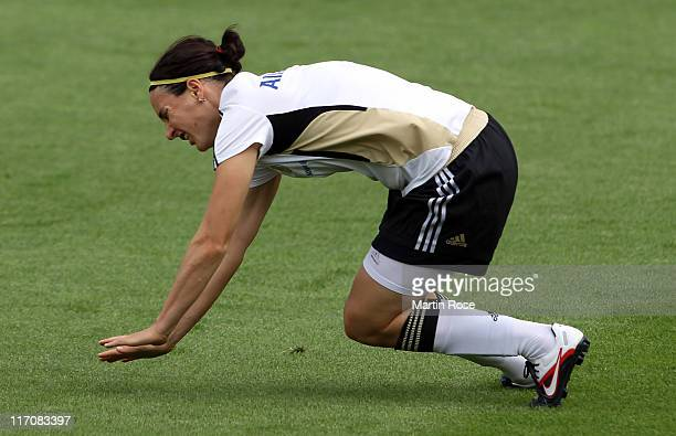 Birgit Prinz of Germany lies on the pitch during the Germany Women national team training session at Wurfplatz stadium on June 21 2011 in Berlin...