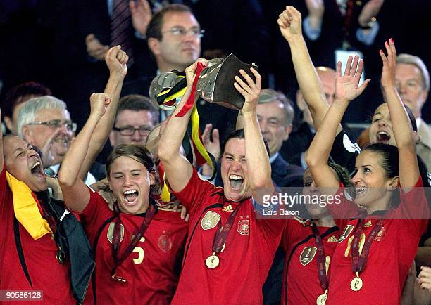 Birgit Prinz of Germany lifts the trophy after winning the UEFA Women's Euro 2009 Final match between England and Germany at the Helsinki Olympic...
