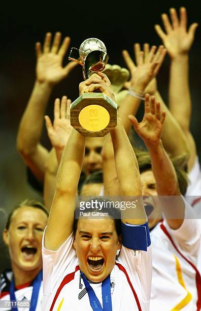 Birgit Prinz of Germany lifts the Women's World Cup after winning the Women's World Cup 2007 Final between Brazil and Germany at Shanghai Hongkou...