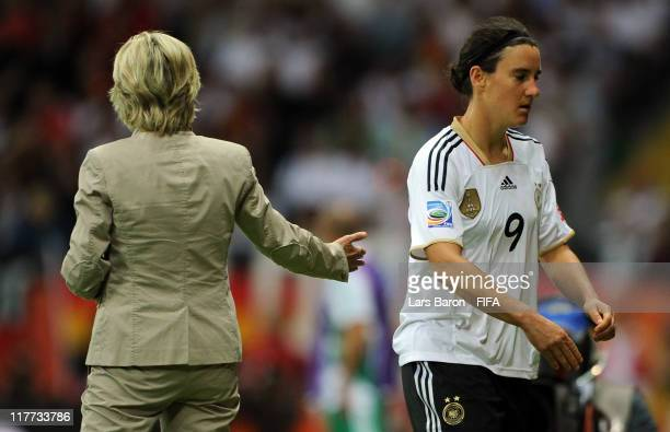 Birgit Prinz of Germany looks dejected next to head coach Silvia Neid after leaving the pitch during the FIFA Women's World Cup 2011 Group A match...