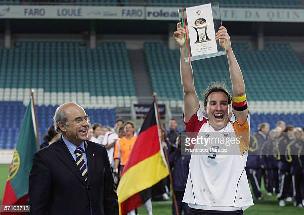 Birgit Prinz of Germany raises the trophy after winning the Womens Algarve Cup match between Germany and USA on March 15, 2006 in Faro, Portugal....