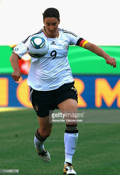 Birgit Prinz of Germany runs with the ball during the International friendly match between Germany and DPR Korea at Audi Sportpark on May 21, 2011 in...
