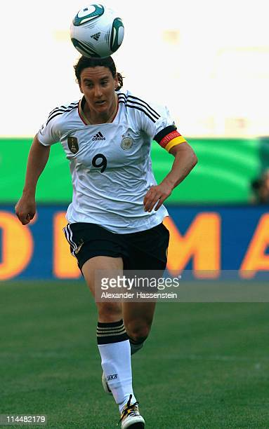 Birgit Prinz of Germany runs with the ball during the International friendly match between Germany and DPR Korea at Audi Sportpark on May 21 2011 in...
