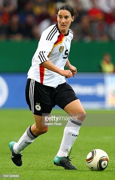 Birgit Prinz of Germany runs with the ball during the Women's International Friendly match between Germnay and Canada at Rudolf Harbig stadium on...