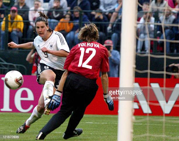Birgit Prinz of Germany scores a goal past Russia's Alla Volkova October 2 at PGE Park in Portland Oregon Germany defeated Russia 71 in The 2003...