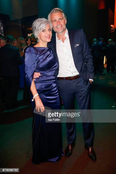 Birgit Schrowange and Frank Spothelfer pose at the Bambi Awards 2017 party at Atrium Tower on November 16 2017 in Berlin Germany