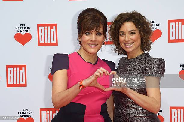 Birgit Schrowange and Isabel Varell attend the Ein Herz Fuer Kinder Gala 2013 at Flughafen Tempelhof on December 7 2013 in Berlin Germany