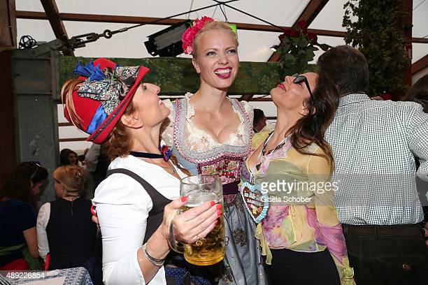 Birgitt Wolff Franziska Knuppe and Naike Rivelli during the Oktoberfest 2015 Opening at Hofbraeu beer tent at Theresienwiese on September 19 2015 in...