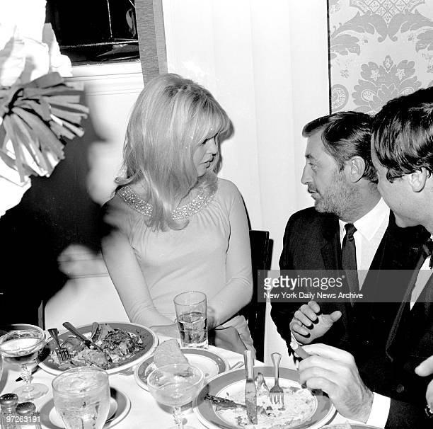Birgitte Bardot and Robert Mitchum chat at a party for Bardot at the Beverly Hills Hotel