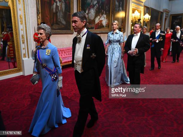 Birgitte, Duchess of Gloucester and the Lord Great Chamberlain arrive through the East Gallery for a State Banquet at Buckingham Palace on June 3,...