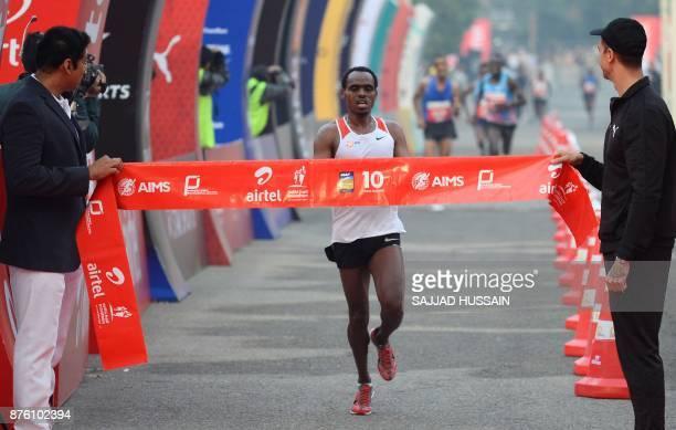 Birhanu Legese of Ethiopia runs towards the finish line to win the Delhi Half Marathon in New Delhi on November 19 2017 In the mens' category of the...