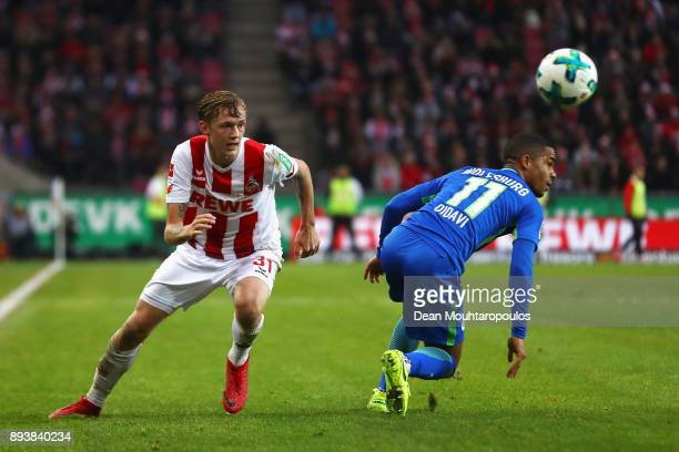 Birk Risa of FC Koeln battles for the ball with Daniel Didavi of Wolfsburg during the Bundesliga match between 1 FC Koeln and VfL Wolfsburg at...