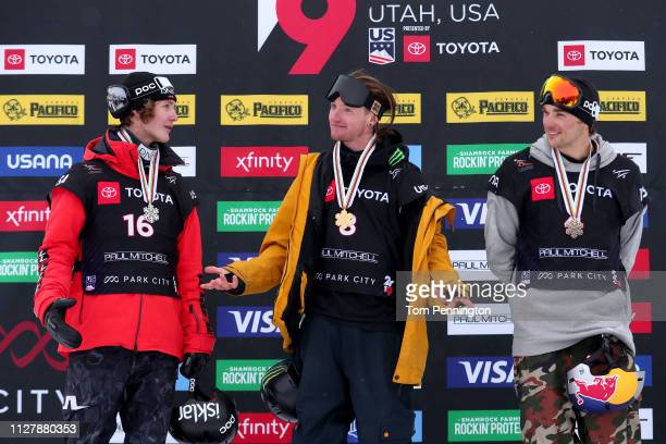 Birk Ruud of Norway in second place James Woods in first place and Nicholas Goepper of the United States in third place celebrate on the podium for...