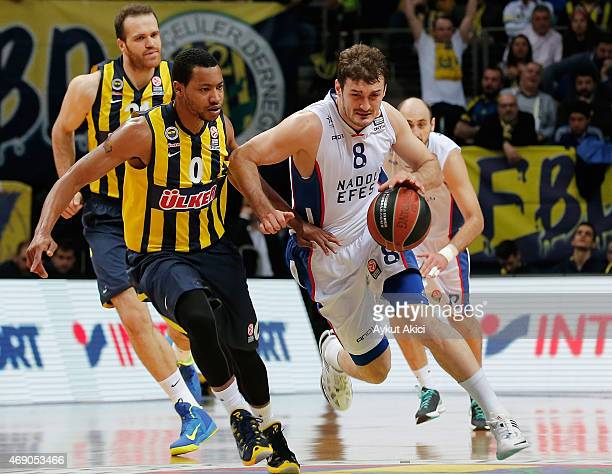 Birkan Batuk #8 of Anadolu Efes Istanbul competes with Andrew Goudelock #0 of Fenerbahce Ulker Istanbul during the Turkish Airlines Euroleague...
