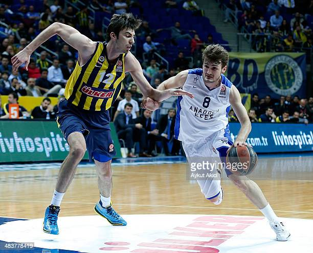 Birkan Batuk #8 of Anadolu Efes Istanbul competes with Izzet Turkyilmaz #12 of Fenerbahce Ulker Istanbul during the 20132014 Turkish Airlines...