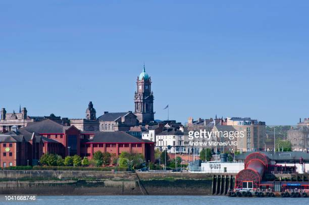 birkenhead skyline across the mersey from liverpool, england. - birkenhead stock pictures, royalty-free photos & images
